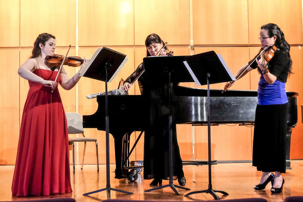 My Senior Recital, playing a trio as an encore with my principal violin teachers from college and high school. How did we get here?